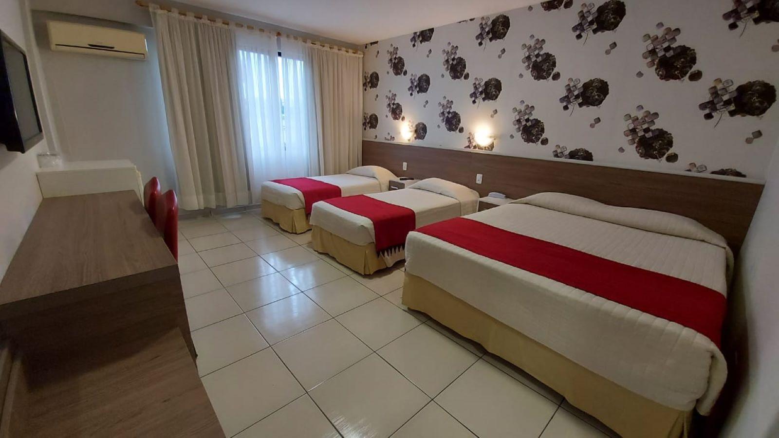 Quádruplo (casal + 2 camas individuais) Luxo